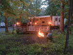 View larger image of Campfire glowing near a trailer site at HARRISONBURGSHENANDOAH VALLEY KOA image #4