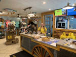 View larger image of Interior of gift shop with smiling staff worker at HARRISONBURGSHENANDOAH VALLEY KOA image #7