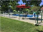 View larger image of View of the swimming pool and chaise lounges at FRIENDSHIP VILLAGE CAMPGROUND  RV PARK image #5