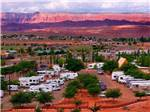 View larger image of An aerial view of the campsites at dusk at PAGE LAKE POWELL CAMPGROUND image #1