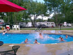 View larger image of Kids at play in the swimming pool at TRAILSIDE RV PARK  STORE image #5