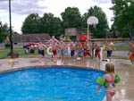 View larger image of Kids ready to jump in the swimming pool at TRAILSIDE RV PARK  STORE image #6
