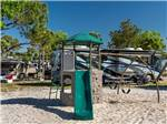 View larger image of Class A motorhome in an RV site at CAMPERS INN image #8