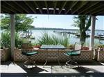 View larger image of A table and chairs overlooking the marina at BAR HARBOR RV PARK  MARINA image #5