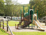 View larger image of Playground at COZY CREEK FAMILY CAMPGROUND image #3
