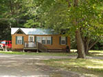 View larger image of Cabin with deck at COZY CREEK FAMILY CAMPGROUND image #4