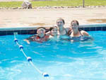 View larger image of A family in the swimming pool at COZY CREEK FAMILY CAMPGROUND image #5