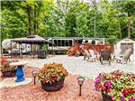 View larger image of RV site with deck fire pit and covered picnic area at TRANQUIL TIMBERS CAMPING RETREAT image #4