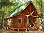View larger image of Cabin with deck at TRANQUIL TIMBERS CAMPING RETREAT image #8