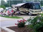View larger image of RVs parked in a row at SUNDERMEIER RV PARK image #1