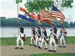 View larger image of Men carrying flags at SUNDERMEIER RV PARK image #2