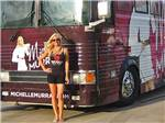 View larger image of Michelle Murray posing by her bus at SUNDERMEIER RV PARK image #6