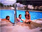 View larger image of Kids swimming in pool at MIDESSA OIL PATCH RV PARK image #9