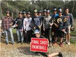 View larger image of A group of people after playing paintball at NATURES CAMPSITES image #3