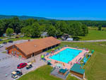 View larger image of An aerial view of the pool and main building at PLEASANT ACRES FARM RV RESORT image #4