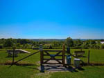 View larger image of A gate leading to the pet area at PLEASANT ACRES FARM RV RESORT image #5