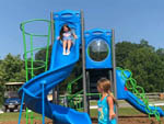 View larger image of Kids playing on the playground equipment at PLEASANT ACRES FARM RV RESORT image #6