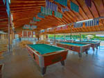 View larger image of Inside of the common area with pool tables at PLEASANT ACRES FARM RV RESORT image #7