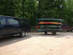 View larger image of Large black van towing kayak rack at WINDING RIVER CAMPGROUND image #3