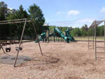 View larger image of Playground with swing set at WINDING RIVER CAMPGROUND image #5