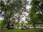 View larger image of One of the empty back in RV sites surrounded by trees at GREENBRIER CAMPGROUND image #5