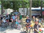 View larger image of Kids biking at CAMP BELL CAMPGROUND image #3