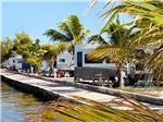 View larger image of Multiple trailers parked alongside dock on the water at JOLLY ROGER RV RESORT image #1