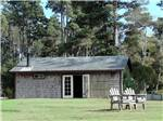 View larger image of Cabins lodging and 2 outdoor chairs at POMO RV PARK  CAMPGROUND image #7