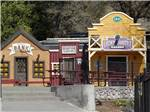 View larger image of A row of rustic rental cabins at WILLITS KOA image #2