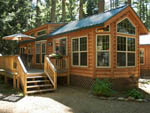 View larger image of Log cabin with deck at PINE ACRES FAMILY CAMPING RESORT image #2