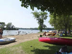 View larger image of People swimming in the lake at RIDEAU ACRES CAMPING RESORT image #3