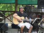View larger image of Man playing music at TALL PINES CAMPGROUND image #5