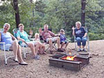 View larger image of People by campfire at TALL PINES CAMPGROUND image #6