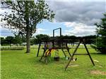 View larger image of Wooden swing set on grass playground at SUN VALLEY CAMPGROUND image #9