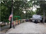 View larger image of Trailer parked in a gravel site with trees at MUSICLAND KAMPGROUND image #10