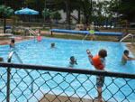 View larger image of Kids swimming in pool at BUFFALO LAKE CAMPING RESORT image #2