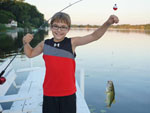 View larger image of Kid fishing at BUFFALO LAKE CAMPING RESORT image #6