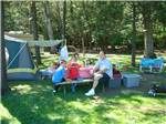 View larger image of Family camping in tent at FOUR SEASONS CAMPGROUNDS image #2
