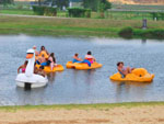 View larger image of Kids rafting at JELLYSTONE PARK WARRENS image #3