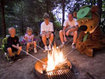 View larger image of Family roasting marshmallows with Yogi at JELLYSTONE PARK WARRENS image #4