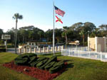 View larger image of Flagpoles at office at CAMELOT RV PARK image #1