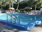 View larger image of Swimming pool with outdoor seating at NAVARRE BEACH CAMPING RESORT image #5