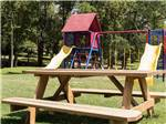 View larger image of Playground with swing set at TREASURE ISLE RV PARK image #5
