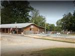 View larger image of Park logo and waterfront at TREASURE ISLE RV PARK image #6