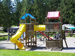 View larger image of Wooden playground with swing set at HAZELMERE RV PARK image #5