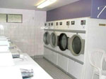 View larger image of Laundry room with washers and dryers at HAZELMERE RV PARK image #10
