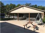 View larger image of Patio area with picnic tables at OSAGE BEACH RV PARK image #6