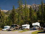 View larger image of Four RVs parked with mountains in the back at FAIRMONT HOT SPRINGS RESORT image #6