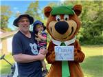 View larger image of Picnic tables and trailers camping at YOGI BEARS JELLYSTONE PARK CAMP-RESORT image #1
