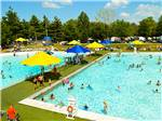 View larger image of Colorful water umbrella and small water slide at BISSELLS HIDEAWAY RESORT image #2